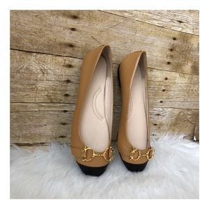 C. WONDER BALLET FLATS WITH GOLD TONE HARDWARE